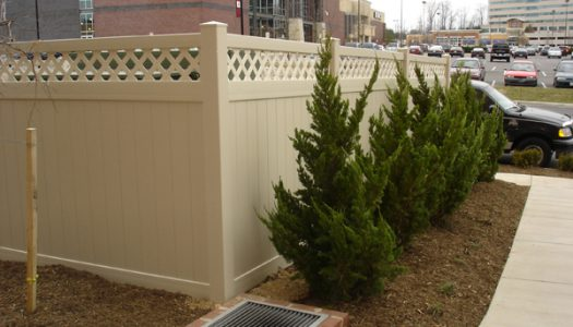 Tan Vinyl Privacy Fence With Lattice Top